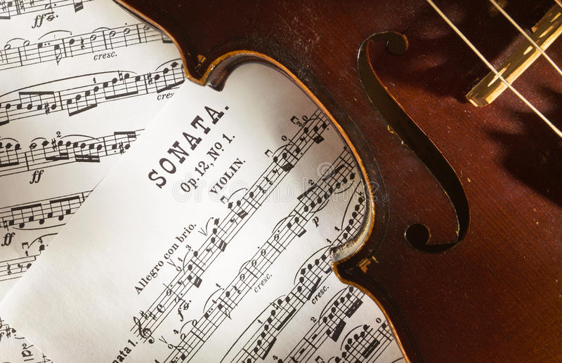 Violin and scores royalty free stock photography