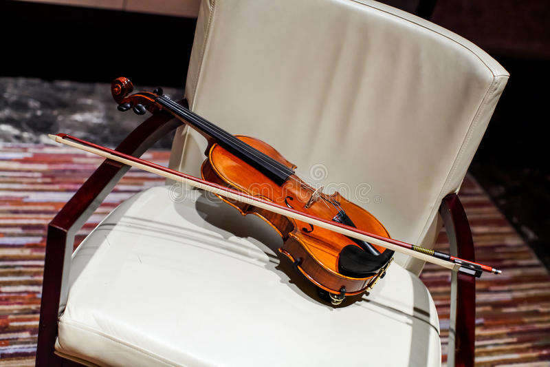 Download Violin on a Chair stock photo. Image of notes, indoors - 29794364