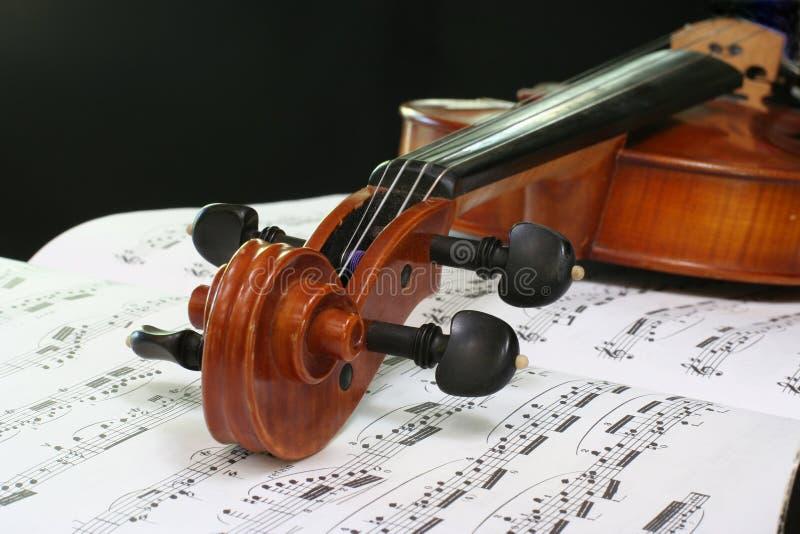 Violin on sheet music royalty free stock photo