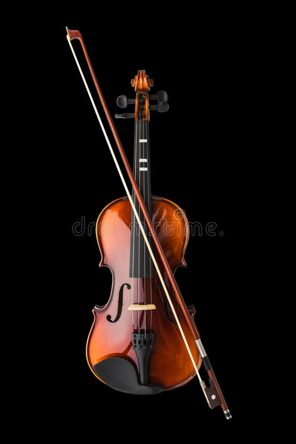 Violin. Shiny violin and bow isolated on black background stock photo