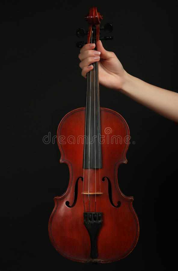 Violin. Stringed bow musical instrument, violin on a black background royalty free stock photography