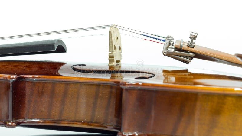 Violin strings. Close up view on violin strings and violin body stock photos