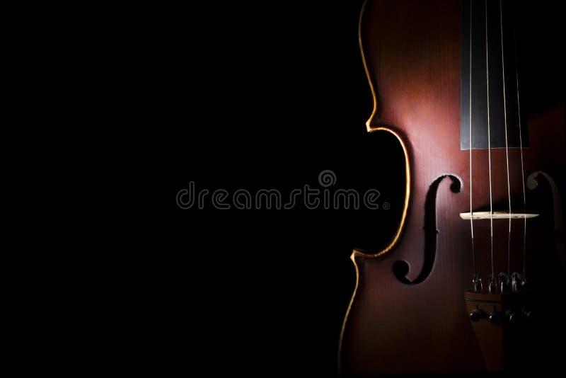 Violin. Vintage violin on black background stock photo