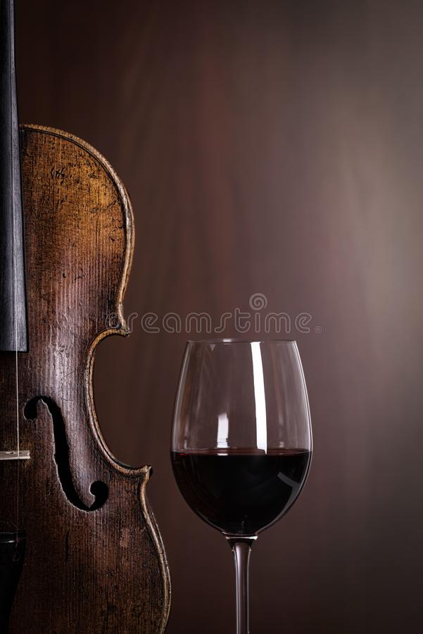 Violin waist detail with glass of wine royalty free stock photos