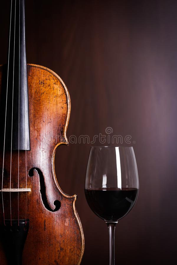 Violin waist detail with glass of wine stock images