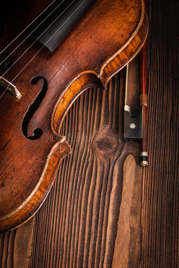 Violin waist detail on rustic wooden background stock photography