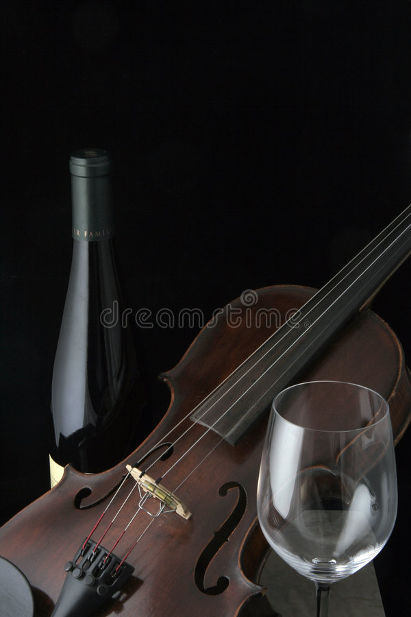 Violin with Wine Bottle and glass royalty free stock photography
