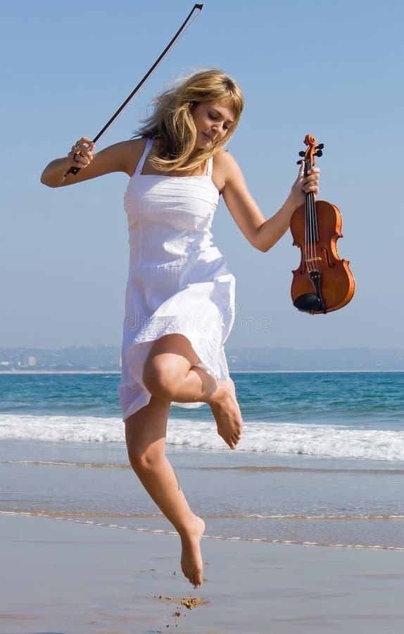 Free Violinist Jump On Beach Stock Photo - 7294470