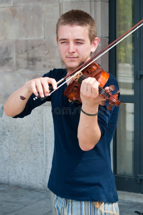 Violinist musician in the street royalty free stock photography