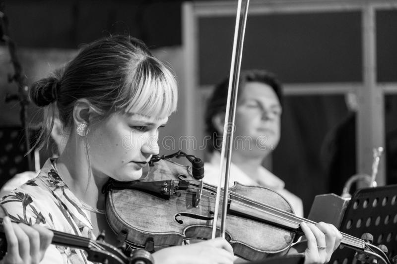 Violinist playing Klezmer at a concert at the Jewish Culture Festival, hosted annually in Kazimierz, Krakow, Poland. Musician playing at a Klezmer concert at the stock image