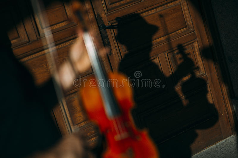 Violinist playing outdoors royalty free stock photos
