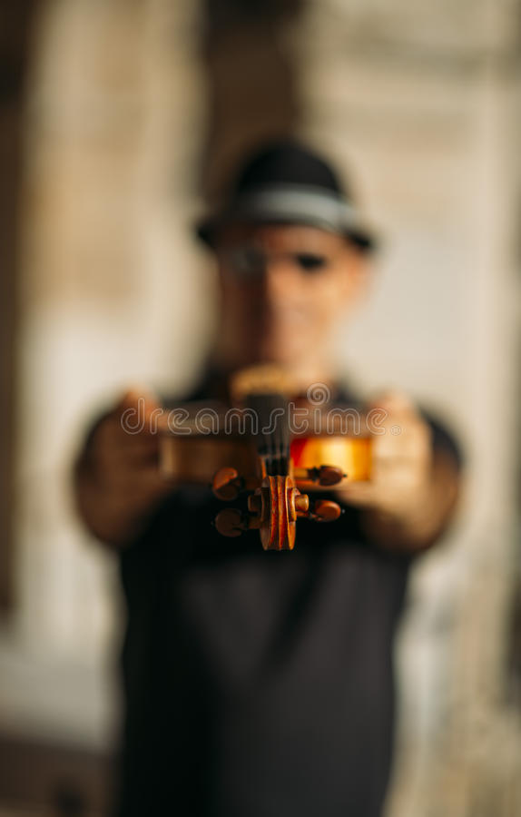 Violinist playing outdoors royalty free stock image
