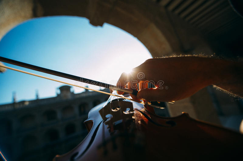Violinist playing outdoors royalty free stock photography
