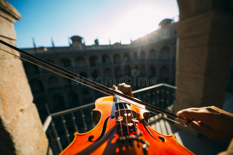 Violinist playing outdoors stock image