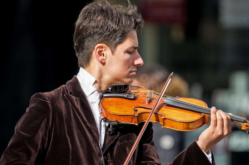Violinist playing in the street 2 royalty free stock photo