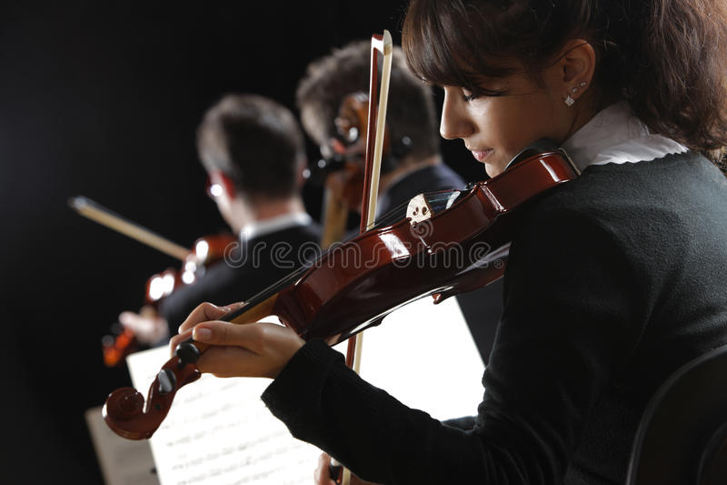Violinist woman. Playing a concert of classical music stock photos