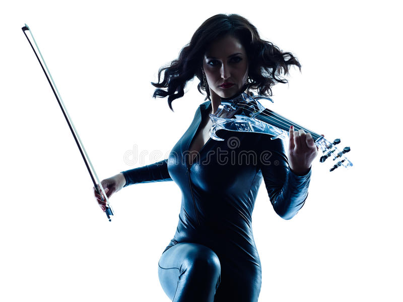 Violinist woman slihouette isolated. One caucasian Violinist woman player playing violon studio slihouette isolated in white background stock photo