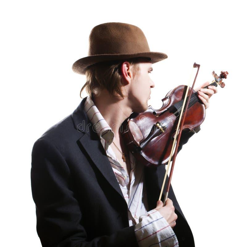 Violinista che gioca il violino in cappello fotografia stock libera da diritti