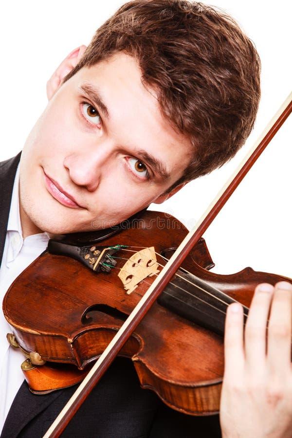 Violinista del hombre que toca el violín. Arte de la música clásica fotografía de archivo