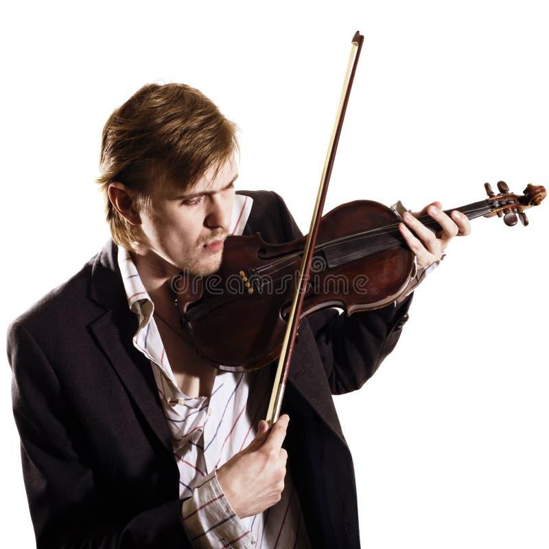 Violinista novo que joga ao violino fotos de stock royalty free