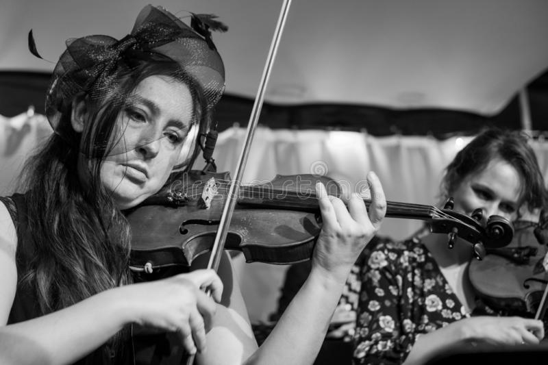 Violinists playing Klezmer at a concert at the Jewish Culture Festival, hosted annually in Kazimierz, Krakow, Poland. Musicians playing at a Klezmer concert at stock photo