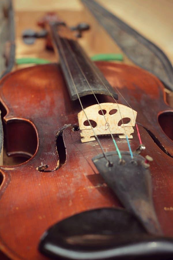 Violino do close-up no estilo do vintage foto de stock royalty free