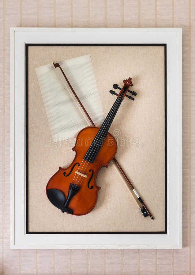 Violon with fiddlestick decoration. In frame royalty free stock images