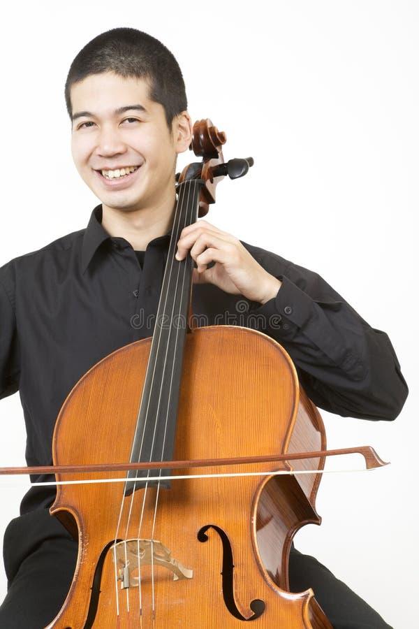 Violoncelista asiático imagens de stock