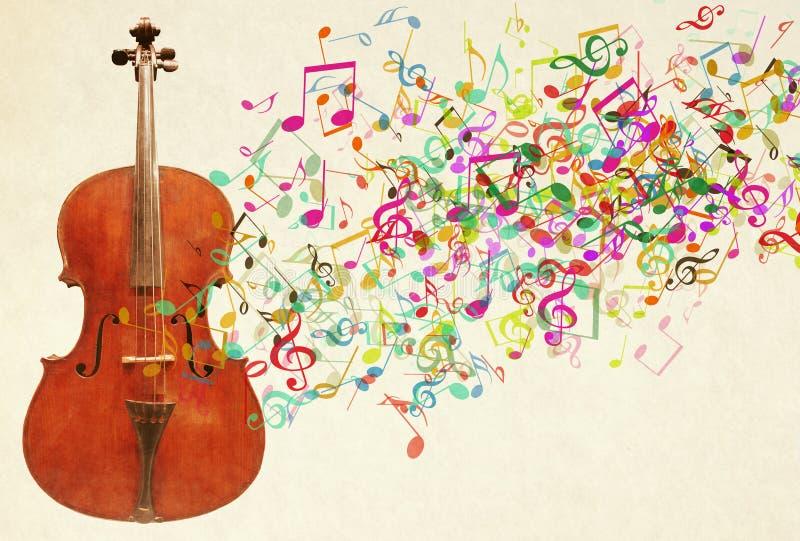 Violoncell och färgrika musikaliska anmärkningar arkivfoto