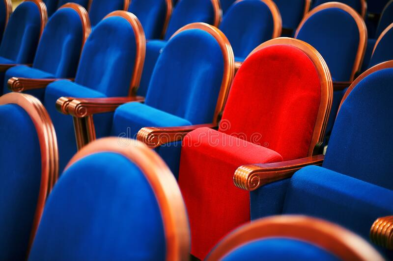 VIP chair in the hall, different from the others. A special place for the leader or guest.  stock image
