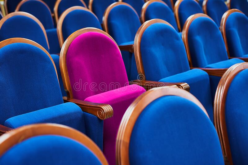 VIP chair in the hall, different from the others. A special place for the leader or guest.  stock photos