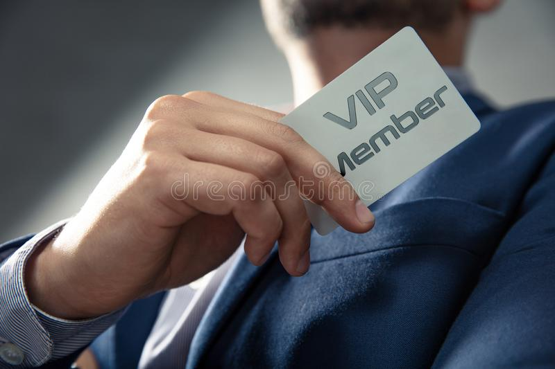 VIP member card holded by an man. VIP member card holded by an elegant man in suit stock photography