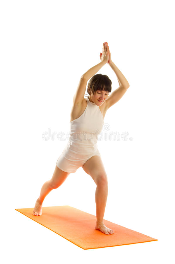 Virabhadrasana I Pose, Warrior Pose. Yoga series: Woman in Virabhadrasana I - Warrior Pose isolated on white background stock photo
