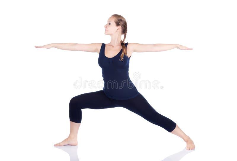 Virabhadrasana II van de yoga strijder stelt royalty-vrije stock fotografie