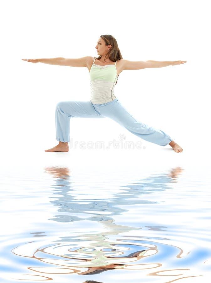 Free Virabhadrasana Warrior Pose On White Sand 4 Stock Photography - 5138492