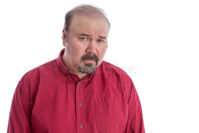 Virada e homem de meia idade olhando de sobrancelhas franzidas desapontado fotografia de stock royalty free