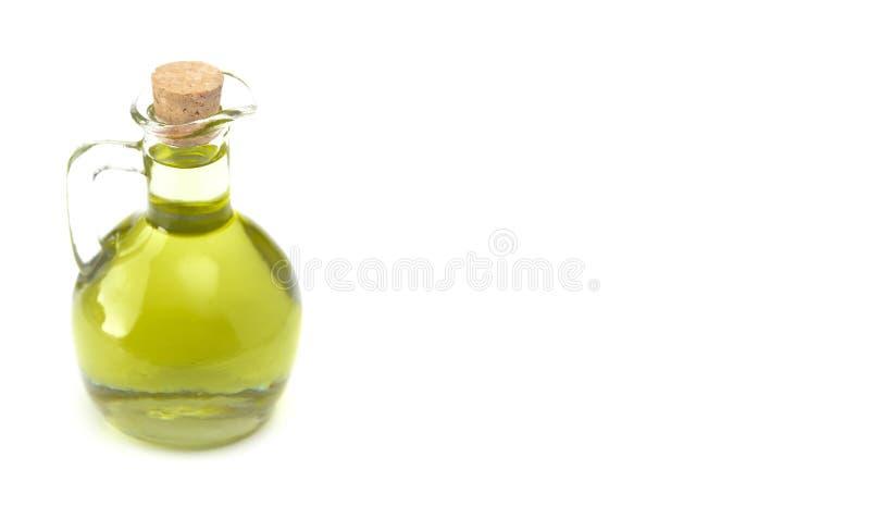 Virgen adicional Olive Oil en una botella tapada con corcho de cristal fotos de archivo