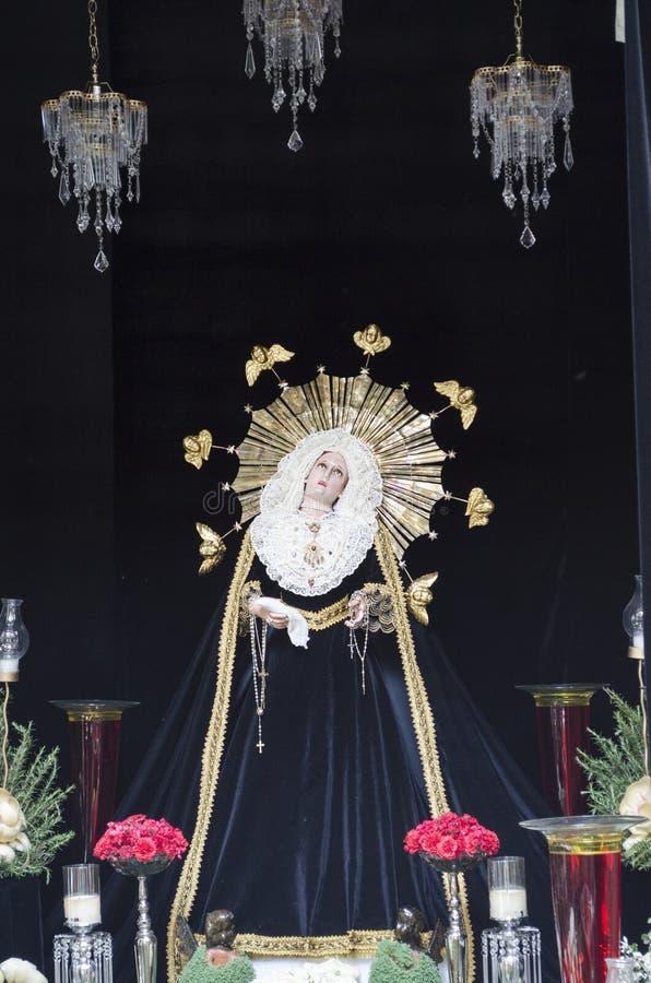 Virgin. Altar. Figurine of a Virgin on an altar with flowers. Oaxaca, Mexico royalty free stock photos