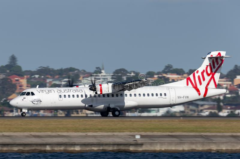 Virgin Australia Airlines ATR ATR-72 twin engine turboprop regional airliner aircraft at Sydney Airport. Sydney, Australia - October 7, 2013: Virgin Australia stock image