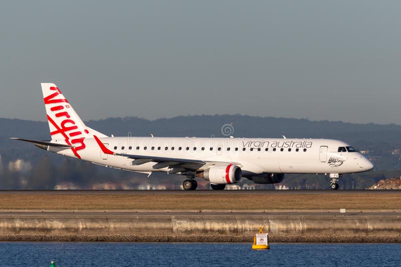 Virgin Australia Airlines Embraer E-190 twin engine regional jet airliner at Sydney Airport. Sydney, Australia - October 9, 2013: Virgin Australia Airlines royalty free stock photos