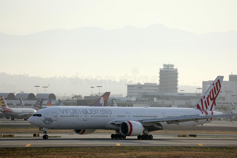 Virgin Australia Airlines in LAX, Los Angeles Airport. Virgin Australia Airlines plane taxiing in LAX airport stock photography