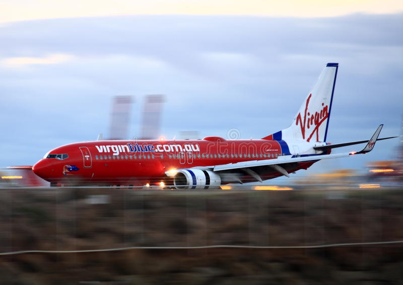 Virgin Blue Boeing 737 in motion on runway. royalty free stock images