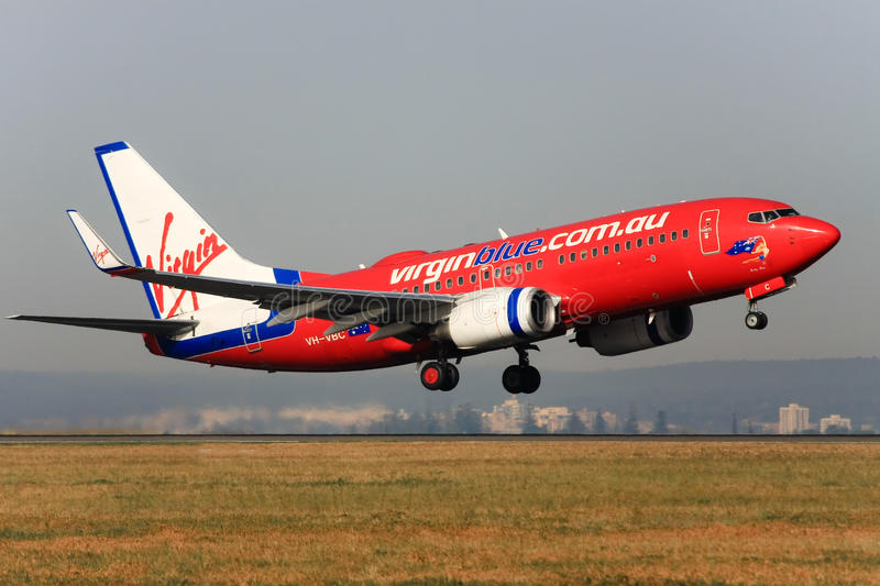Virgin Blue Boeing 737 taking off. royalty free stock photography