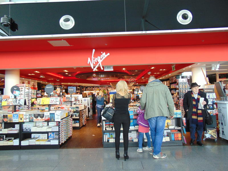 Virgin Airport Book Store. Customers at a Virgin store located inside airport in Poland. Selection of books on display and CCTV cameras looking over shop royalty free stock images