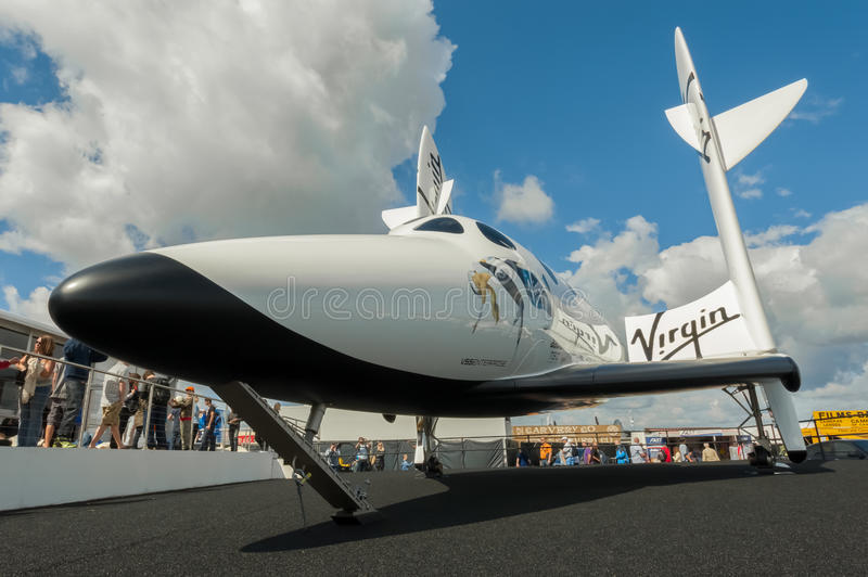 Virgin Galactic. The futuristic Virgin Galactic reuseable, sub-orbital spacecraft on static display at the Farnborough International Airshow, UK on July 15, 2012 royalty free stock photos