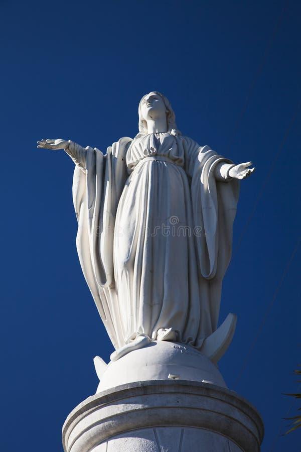 Virgin Maria Monument on San Cristobal vertical stock image