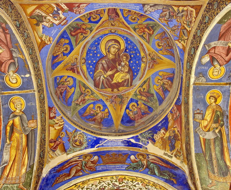 Orthodox church. Virgin Mary and Child - Hurezi or Horezu Monastery, landmark attraction in Romania. Orthodox church. Painting on the ceiling with the Virgin royalty free stock photography