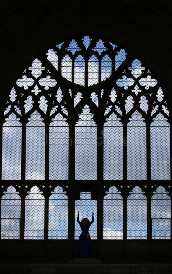 Virgin Mary in gothic window. In Ely Cathedral stock photos