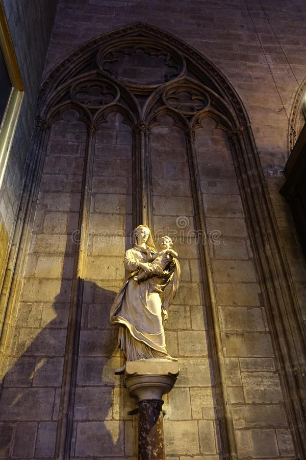 Virgin Mary with Infant Marble Sculpture Notre Dame Paris stock photo