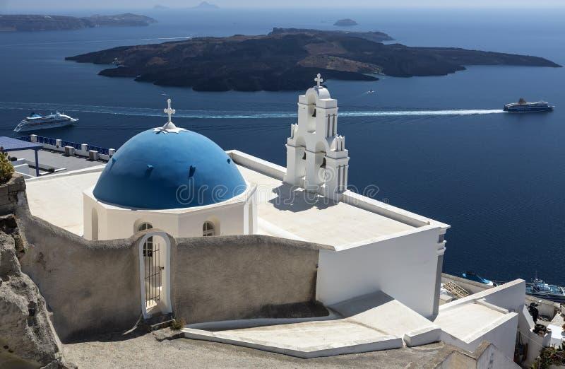 Virgin Mary Orthodox Church, Three bells of Fira Church in Fira, Santorini island, Greece stock photo